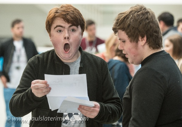 A student reacts to his exam results at Sir John Hunt Community Sports College, Plymouth, Devon.