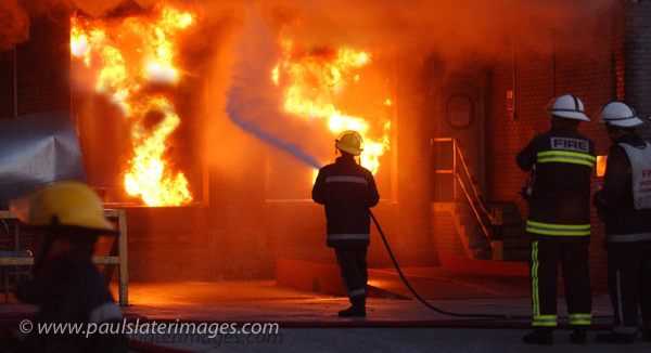 Fire Fighter in action, Plymouth, Devon.