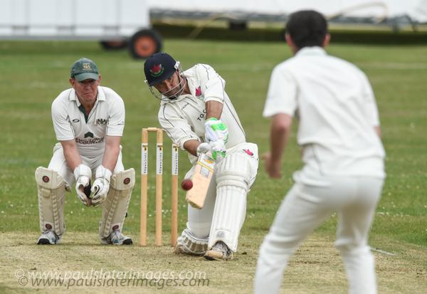 Cricket action, Plymouth, Devon