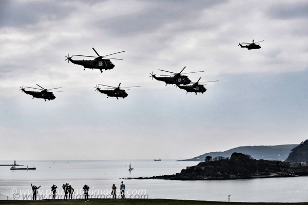 Sea King Helicopters make their way  along Plymouth Hoe as part of a farewell tour of the region.