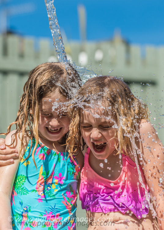 Olivia and Jess cool down during the 2017 Heatwave across Devon, UK.