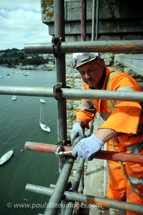 Construction worker on the underside of the Tamar Bridge between Devon and Cornwall.