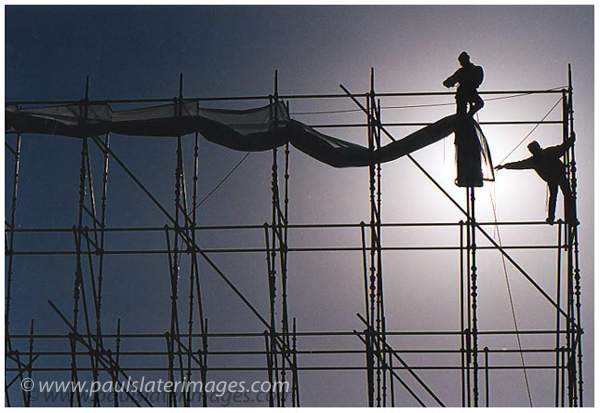 Construction workers erect a huge viewing screen on Plymouth Hoe, Devon.