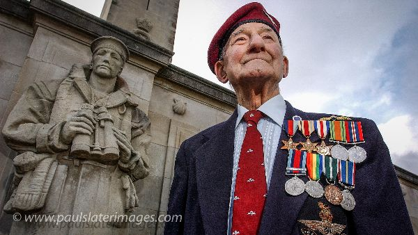 A World War 2 veteran proudly displays his campaign medals at the Naval War Memorial on Plymouth Hoe, Devon.