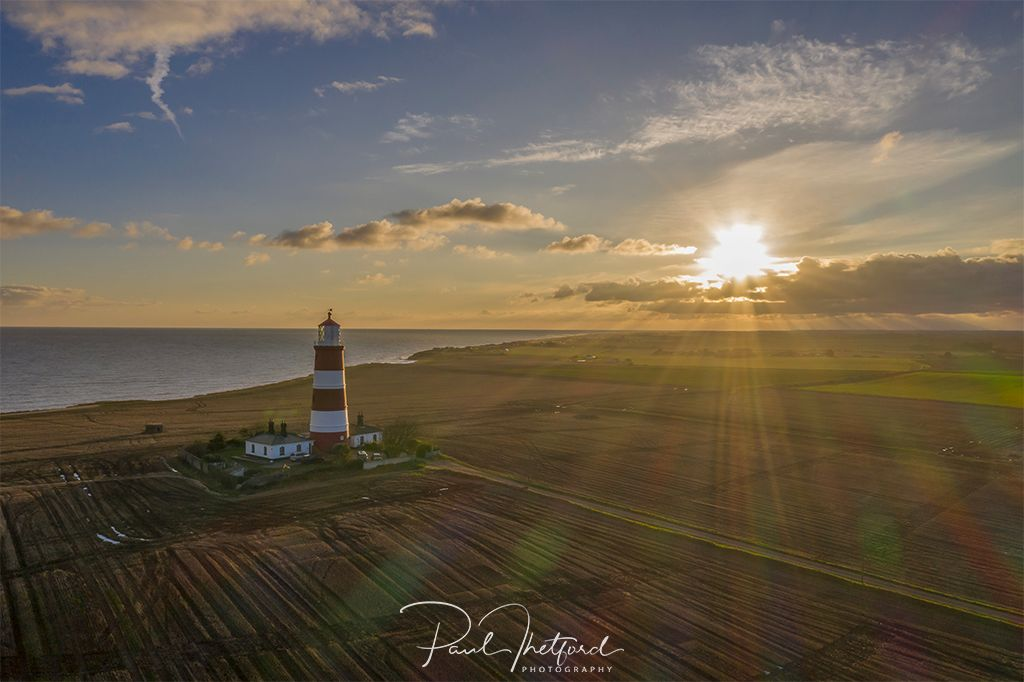 Happisburgh Lighthouse into the sun