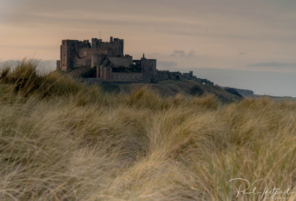 Bamburgh Castle through the dunes