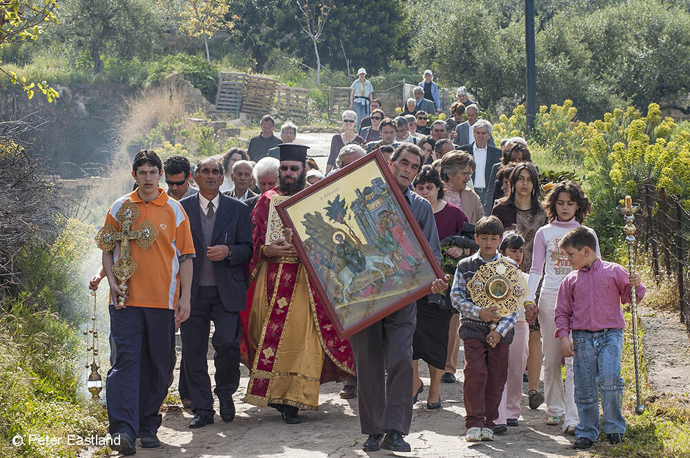 Palm Sunday procession, priest and villagers tour the the village of Proastio, in the Outer Mani, Messinia, Greece.<BR><BR><BR><br><br><br><br>