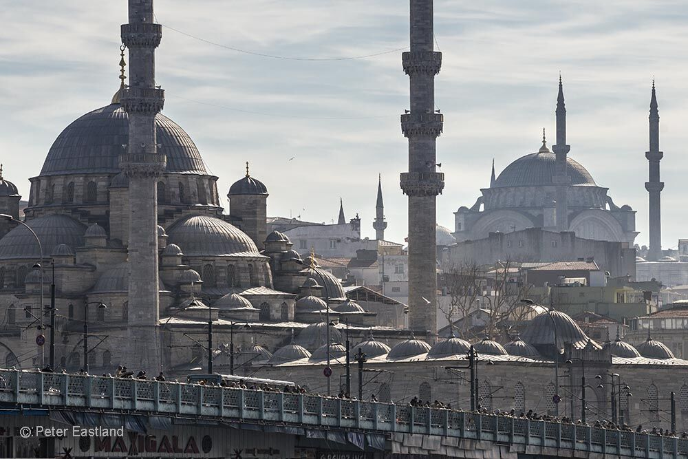 Looking across Galata bridge to the Yeni mosque at Eminonu with the Suleymaniye mosque on the skyline. Istanbul, Turkey.<br><br><br><br><br><br>