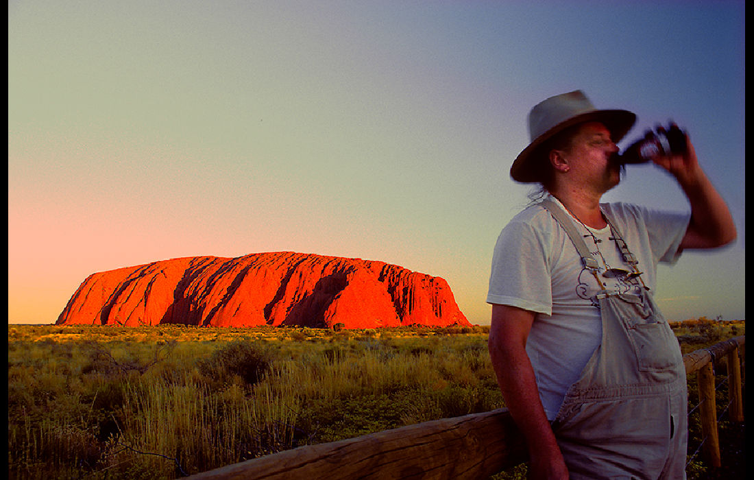 Beer drinking Australian not looking at the sun setting on Ayers Rock 1989