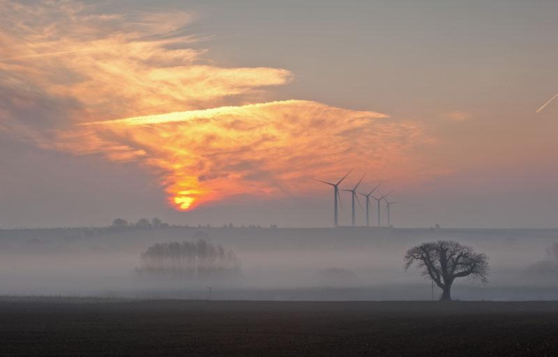 Sunrise over the Watchfield Wind Farm