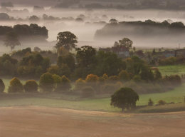 Farm on a Misty Morning