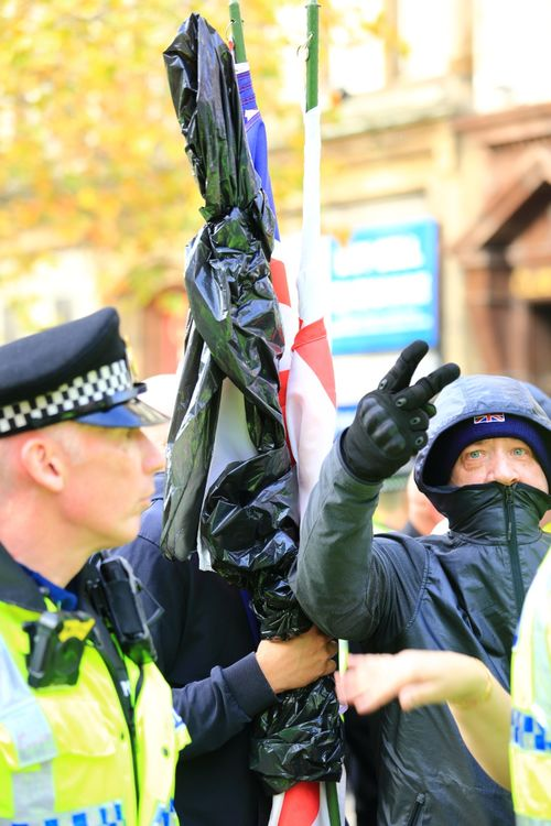 English Defence League Protester Gives The Photographer The V Sign During Demonstrations In Manchester Piccadilly Gardens UK