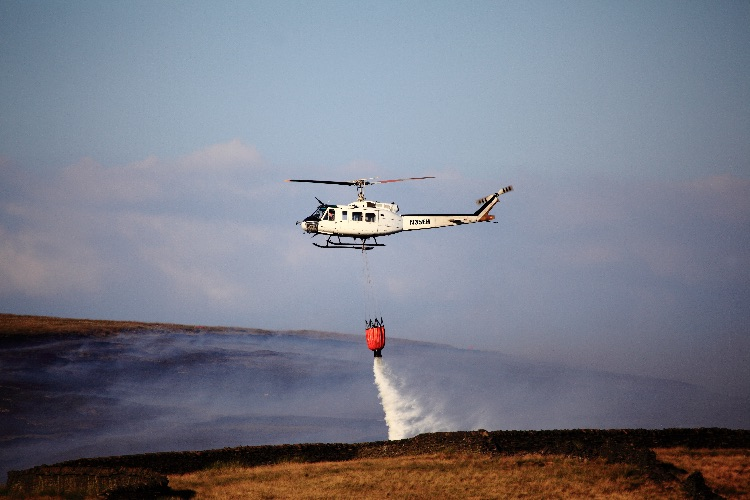 Helicopter Drops Water Over The Fires Raging On Saddleworth Moor Diggle UK
