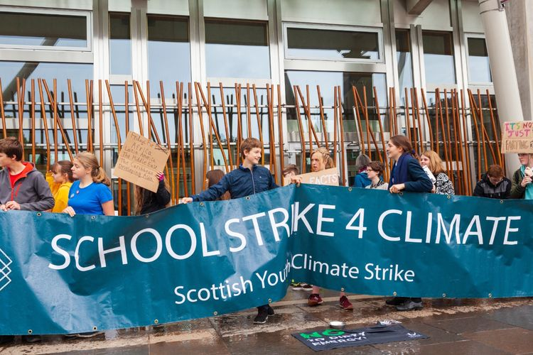 SCHOOLS 4 STRIKE child climate protesters demonstrating outside the Scottish Parliament Buildings in Edinburgh September 2019