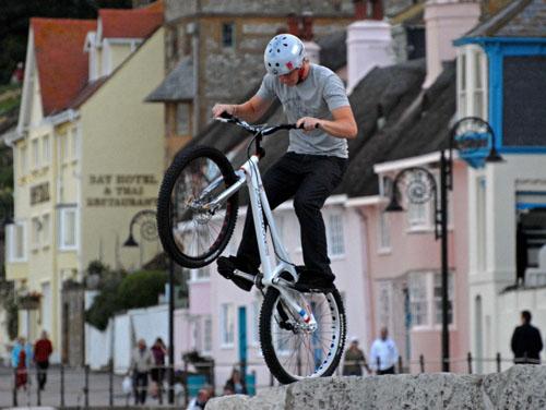 Balancing young biker, Lyme Regis sea front