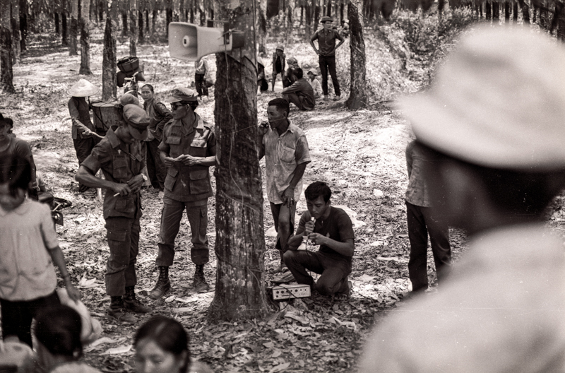 South Vietnamese soldiers making announcements to displaced persons