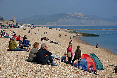 Relaxing on Lyme Regis beach