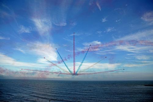 Red Arrows bursting over Lyme Bay