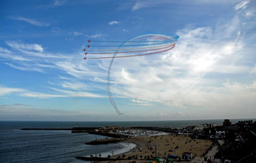 The Red Arrows looping over Lyme Regis harbour and the Cobb