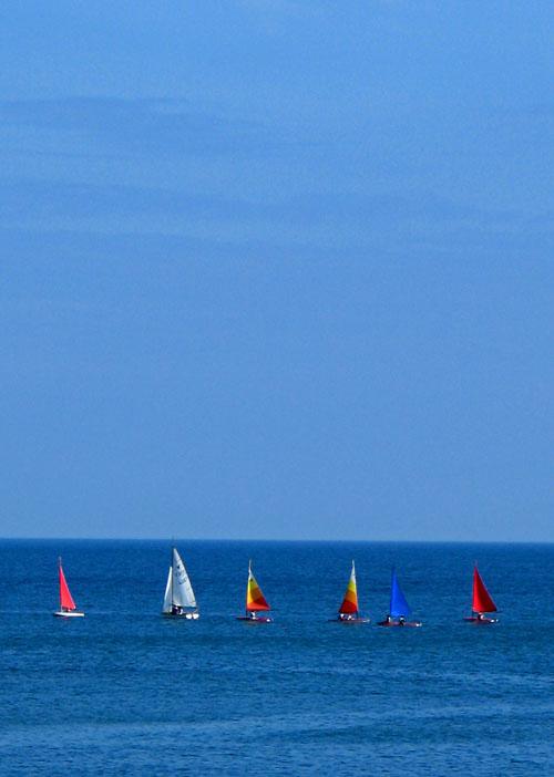 Sailing boats on a blue sea