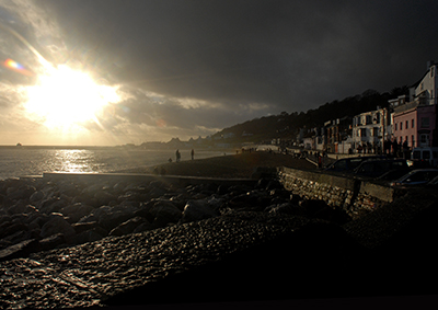 Winter afternoon sunlight hitting the sea front at Lyme Regis