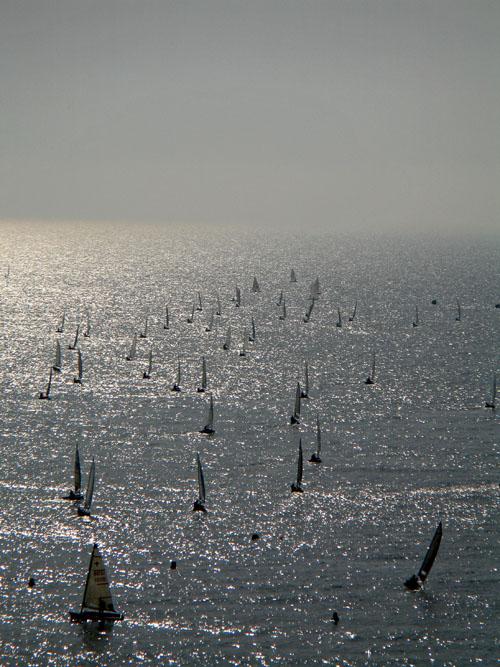 Sailing regatta on a sunlit sea