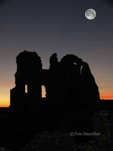 Ogmore castle and moon at sunset