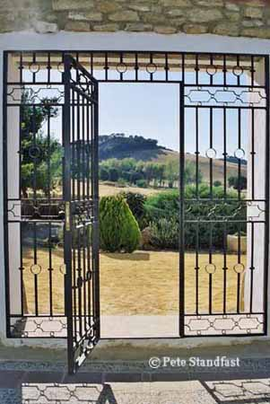 View through an open gate, Cortijo Las Piletas, Ronda, Spain