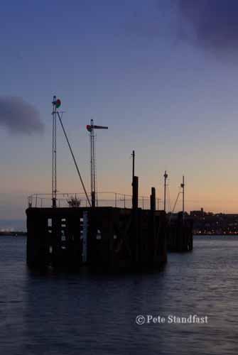 The Semaphore signals at dusk, Cardiff Bay