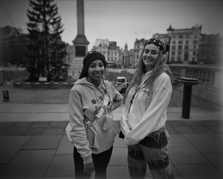 Trafalgar Square street portrait: two girls from Wiltshire.