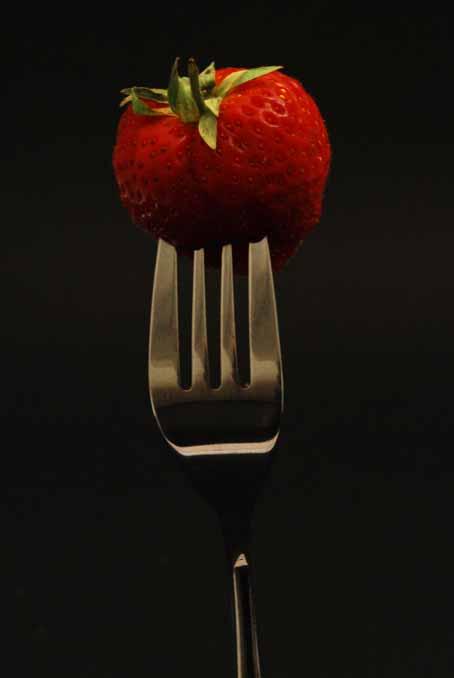 Strawberry on fork (dark)