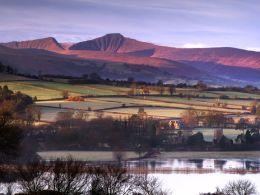Dawn, Llangorse Lake and the Brecon Beacons.