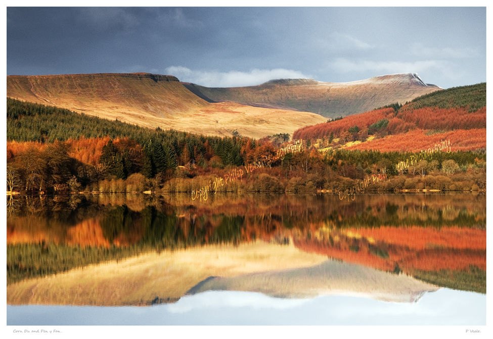 A near perfect reflection of Corn Du and Pen y Fan in the calm water of Pentwyn Reservoir, the Brecon Beacons National Park.