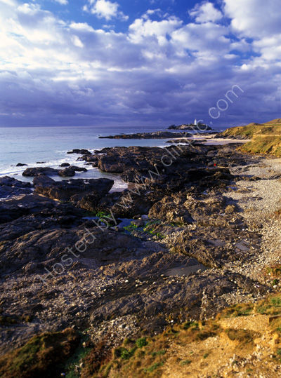 Godrevy Point with rocks exposed at low tide.