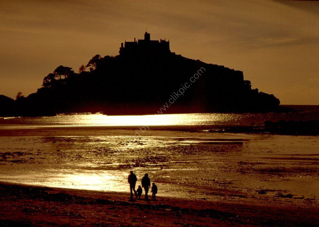 A walk on the beach in golden evening light, St Michael's Mount.