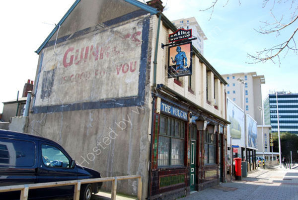 Vulcan Inn Cardiff and Guinness advert in 2008 before demolition.
