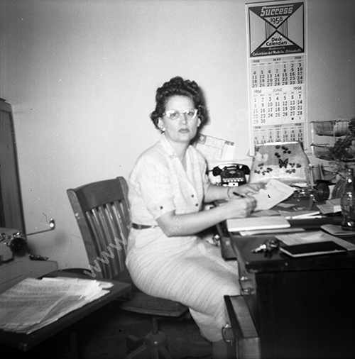 office worker with 1958 calendar.