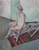 Sarah sitting on wooden deckchair