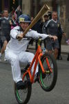 Danny Mackaskill carrying the Olympic torch through Glasgow in 2012. This was one of my first images that was licenced.