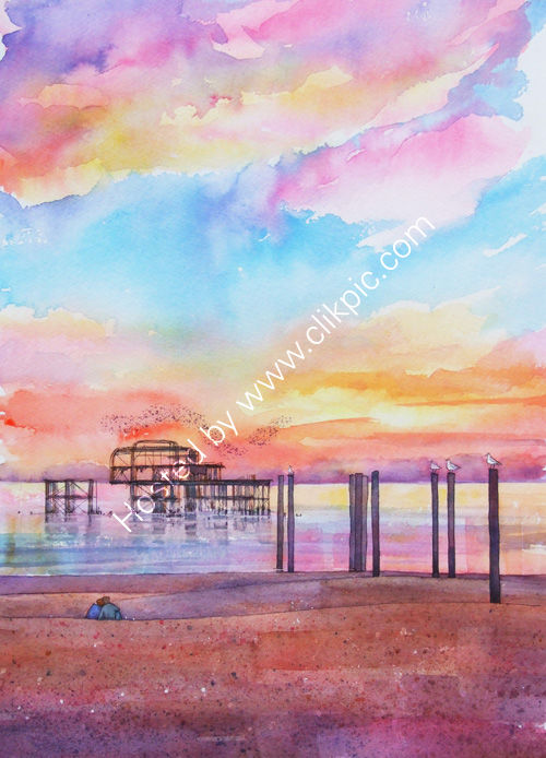 a starling murmuration over the West Pier, Brighton and a pink sunset