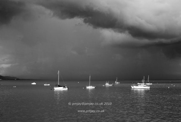 The small boats await the brewing storm