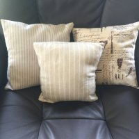 Vintage style fabric cushion covers.