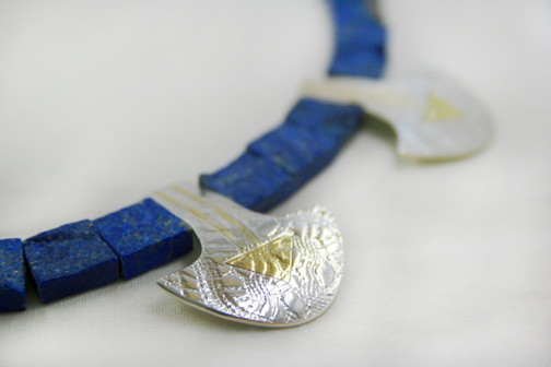 Rough lapis lazuli with silver and 18ct gold.
