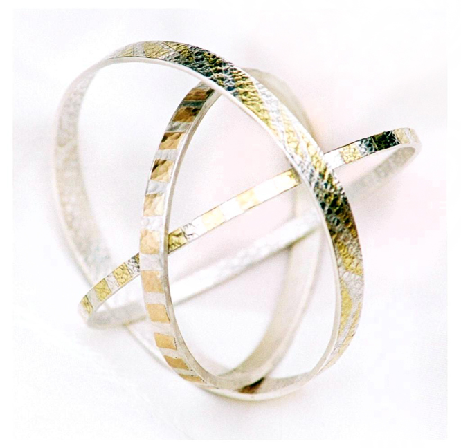 Sterling Silver and gold bangles textured with lace