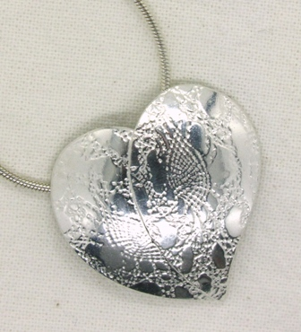 Heart pendantwith lace texture