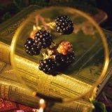 Blackberries and vintage books, still life.