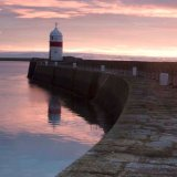 Sunrise over Castletown Breakwater