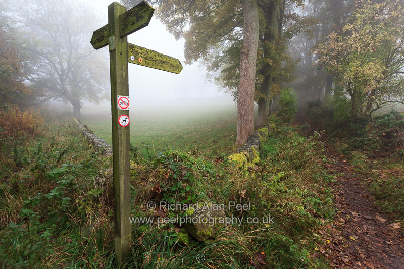 Signpost and footpaths Bronte Way near Haworth West Yorkshire England UK