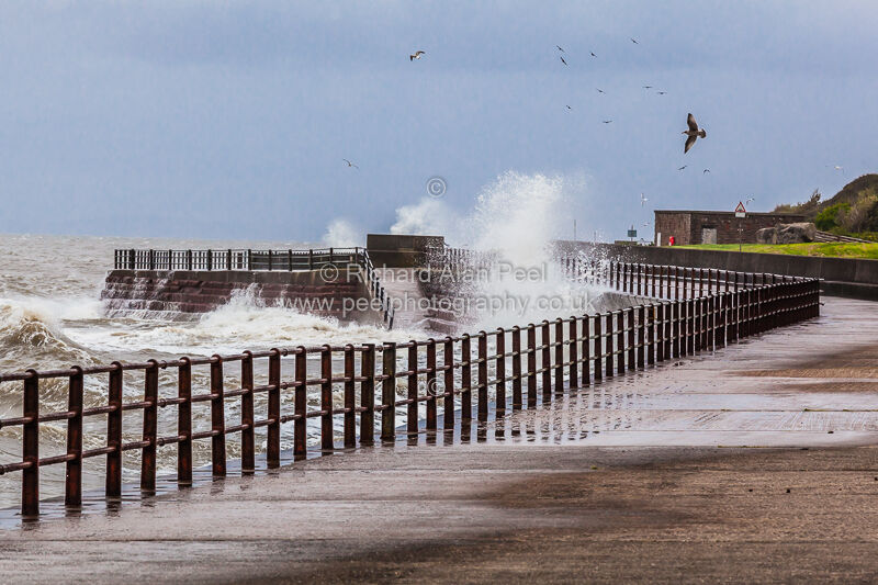 Breaking waves and rough sea Maryport Cumbria England UK