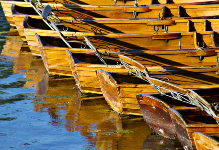 Rowing boats on the river Stour Dedham, Essex
